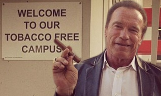 Arnold Schwarzenegger defies smoking rules